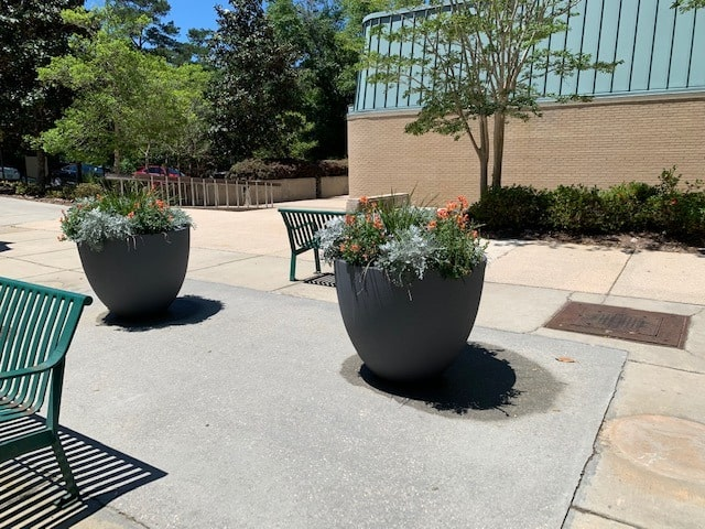 Modern designed outdoor pot plants with flowers