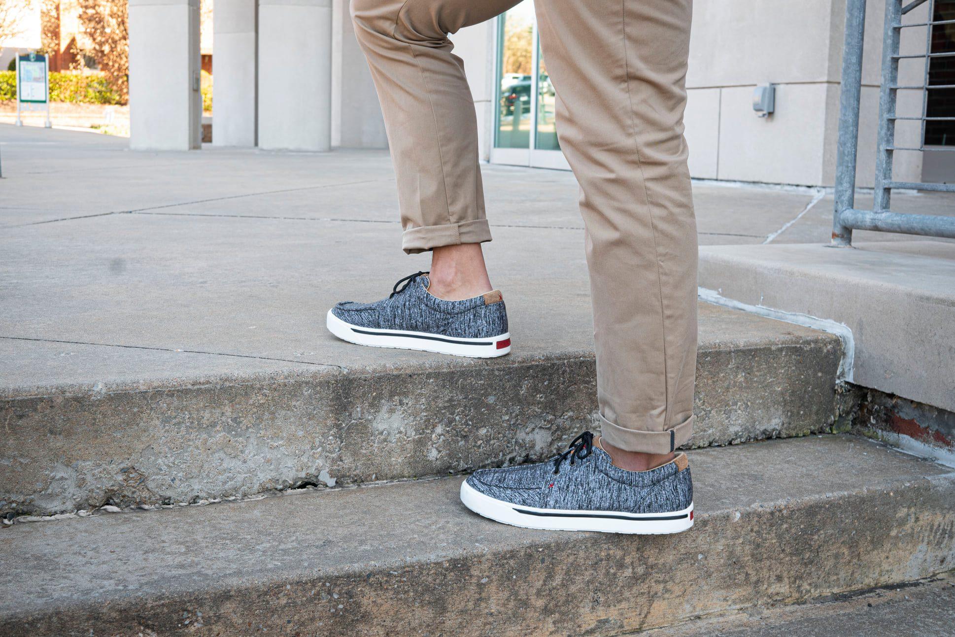 Man wearing modern gray patterned Twisted X sneakers