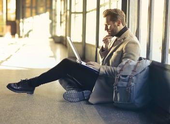 thinking-man-laptop-airport